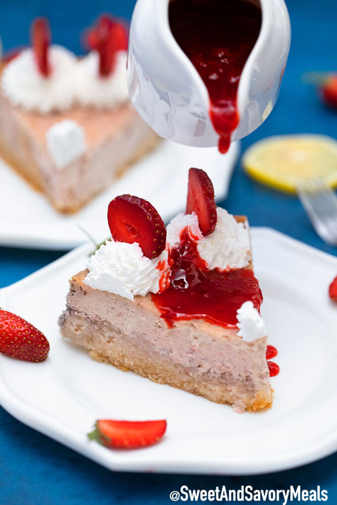 Picture of Keto strawberry cheesecake with strawberry sauce.