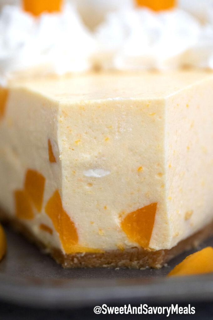 Image of no bake peach cheesecake close.