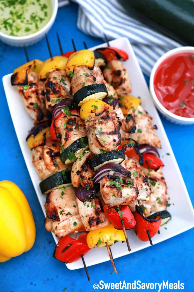 Plate of Grilled chicken skewers.
