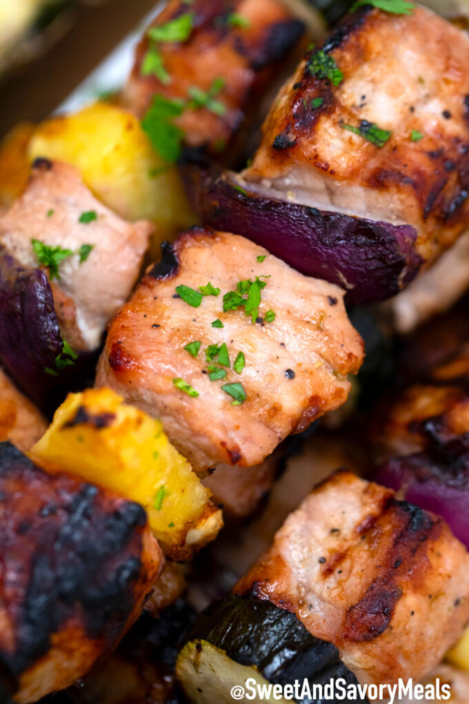 Grilled pork skewers with pineapple and onions.