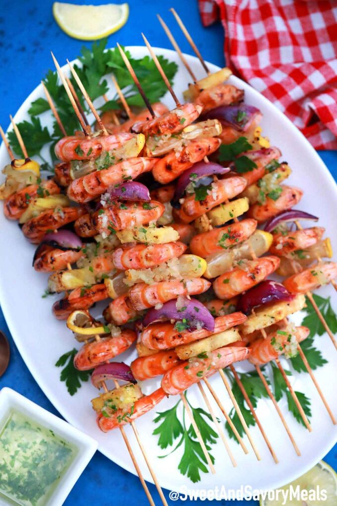 Shrimp kebabs on a white plate