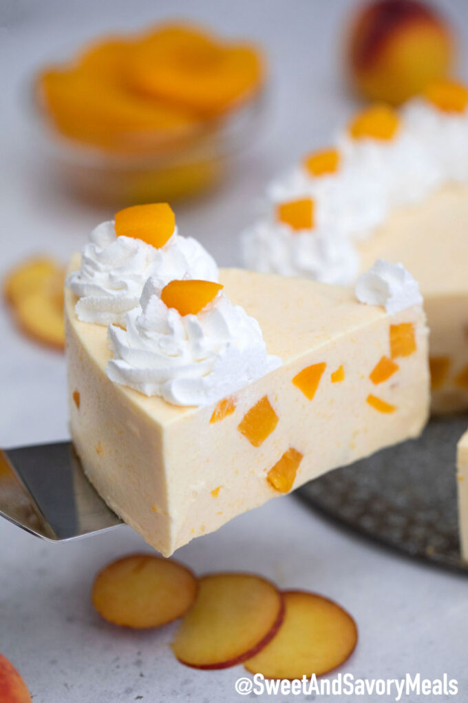 Photo of a slice of no bake peach cheesecake.