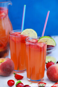 Picture of peach sangria with cherries and strawberries.