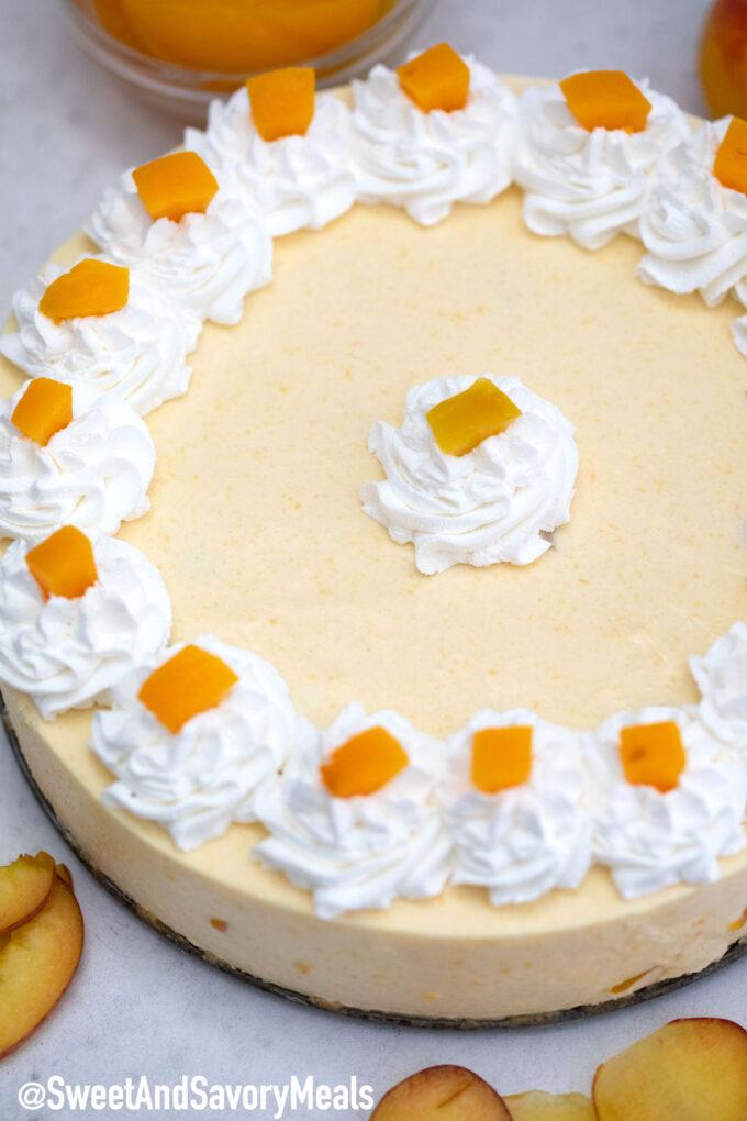Photo of no bake peach cheesecake.