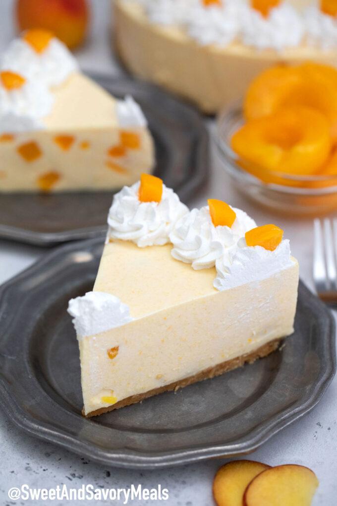 Photo of no bake peach cheesecake slice.
