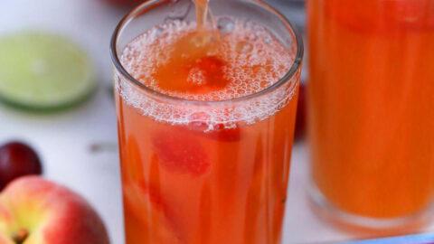 Photo of pouring peach sangria.