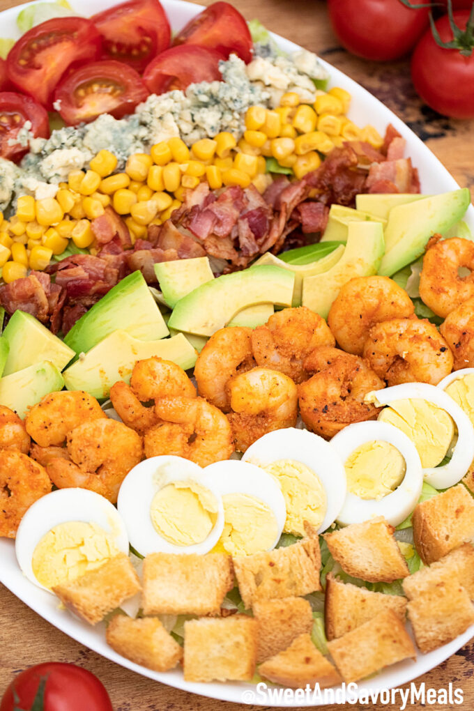 Shrimp Cobb Salad with bacon avocado eggs and blue cheese.