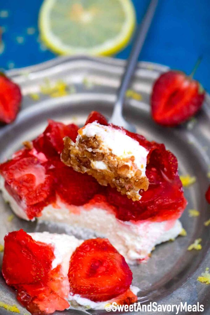 strawberry pretzel salad bite on a plate.