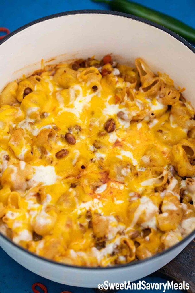 Cheesy Chili Mac in a white dutch oven.