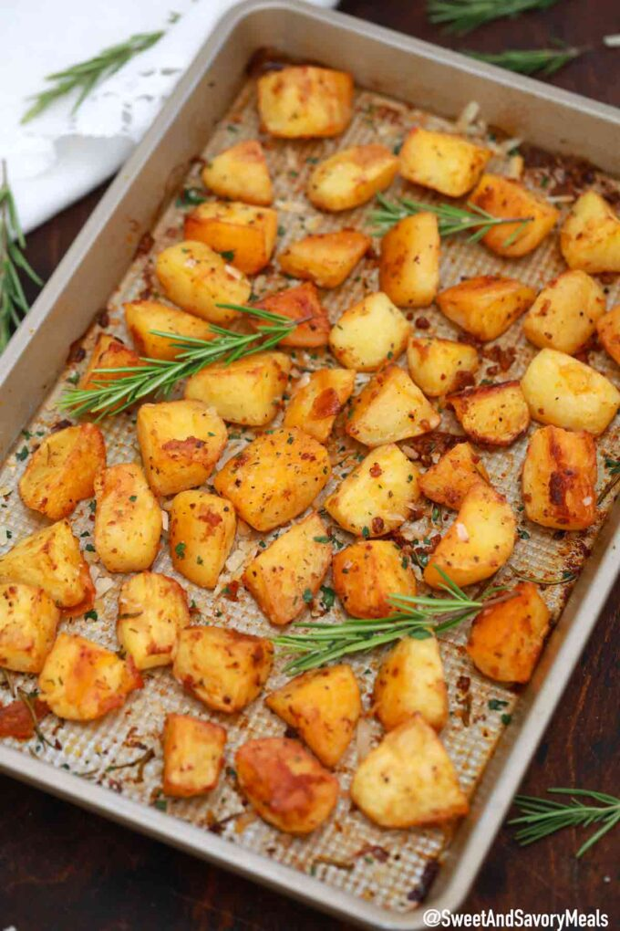 crispy garlic roasted potatoes on a baking sheet