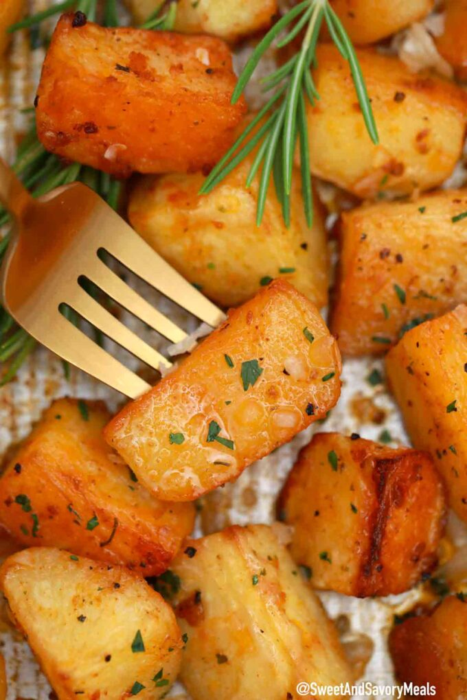 crispy garlic roasted potatoes on a fork