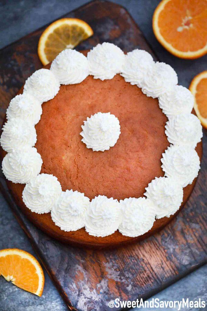 Orange cake with whipped cream.
