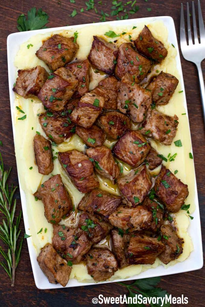 garlic butter steak bites with mashed potatoes