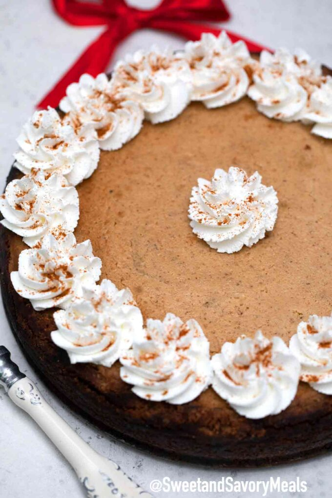 gingerbread cheesecake with whipped cream