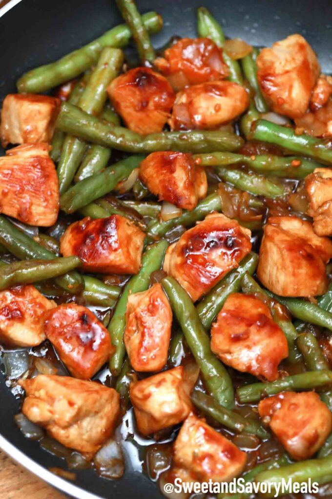 Panda Express string bean chicken breast with sesame seeds in a pan