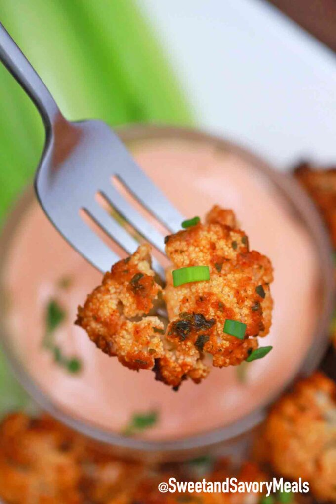 air fryer buffalo cauliflower wings on a fork