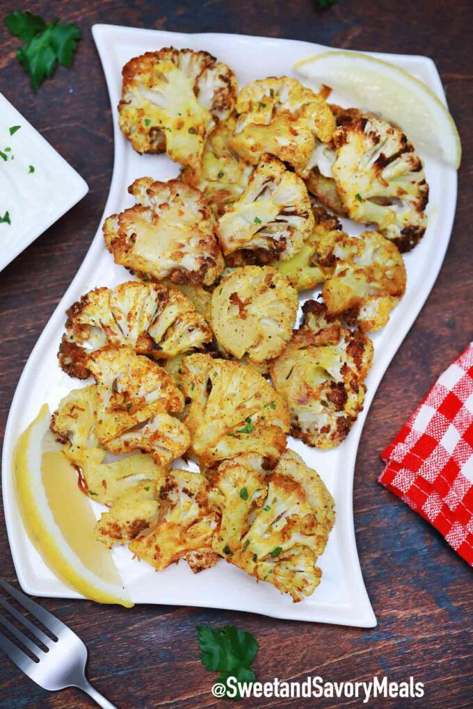 air fryer cauliflower with lemon on a plate
