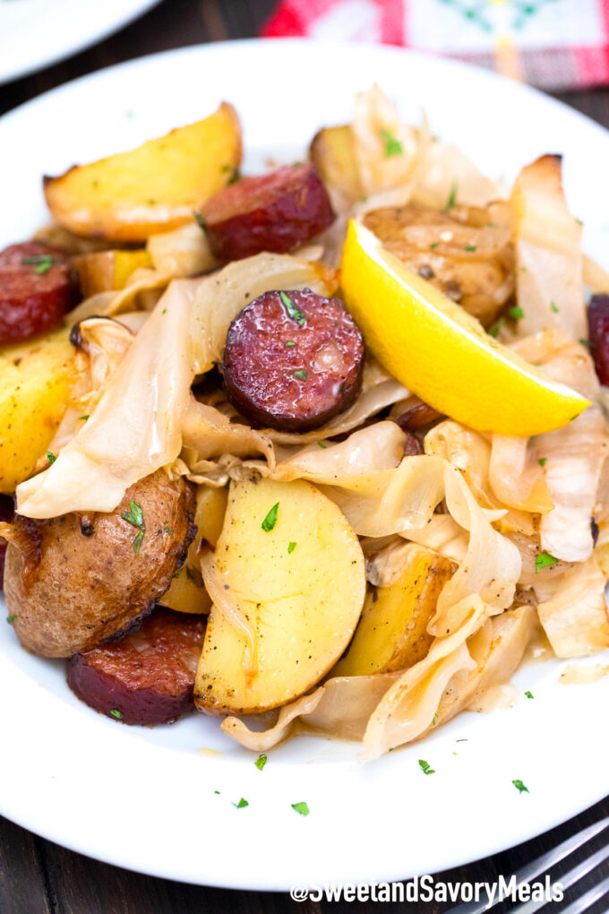 cabbage and sausage with a lemon wedge