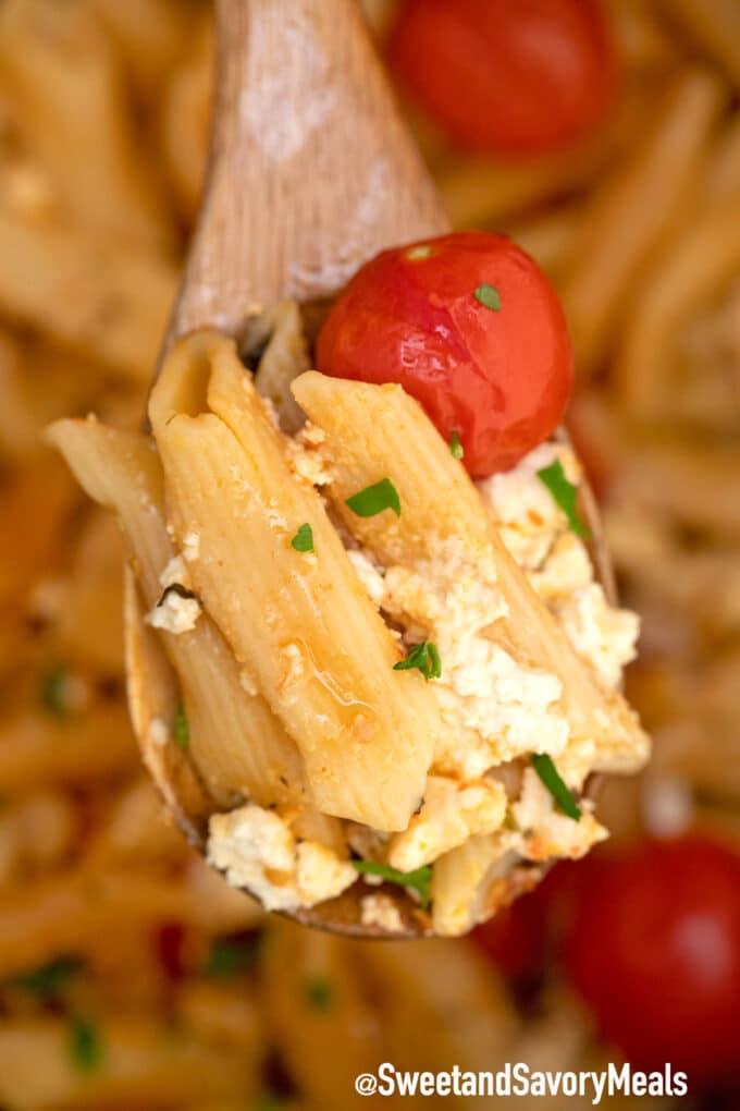 instant pot feta pasta on a wooden spoon