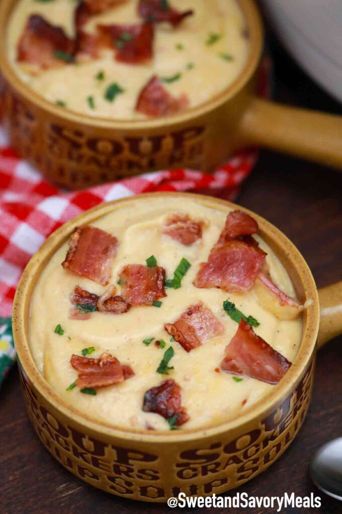 potato and cabbage soup with bacon in bowls