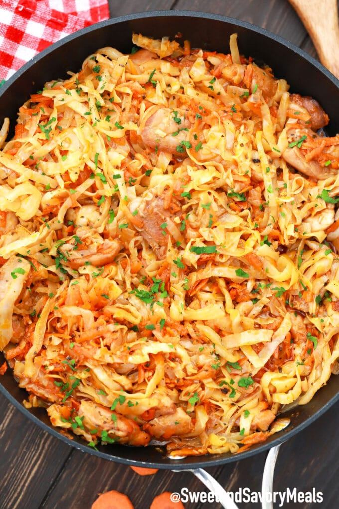 chicken and cabbage stir fry in a pan