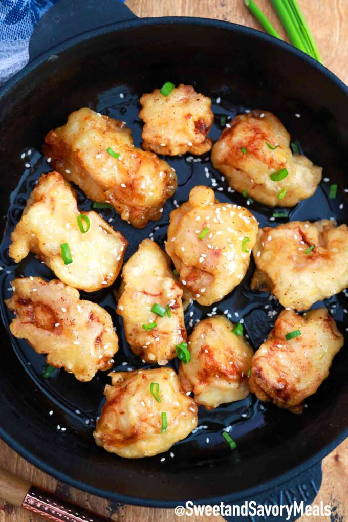 crispy honey chicken in a frying pan