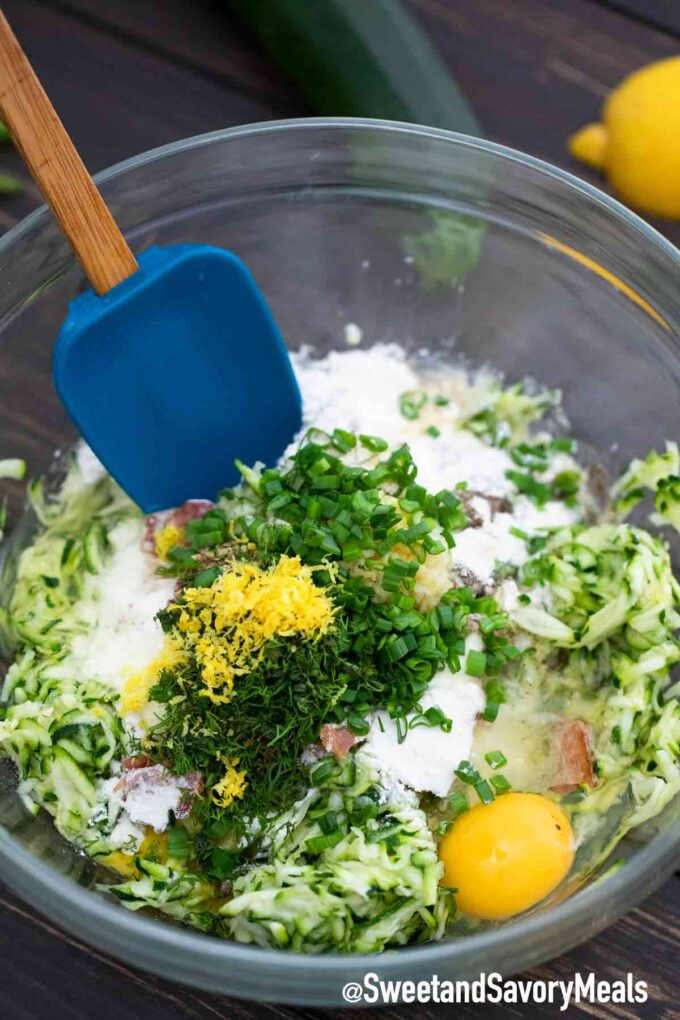 zucchini fritters ingredients in a bowl