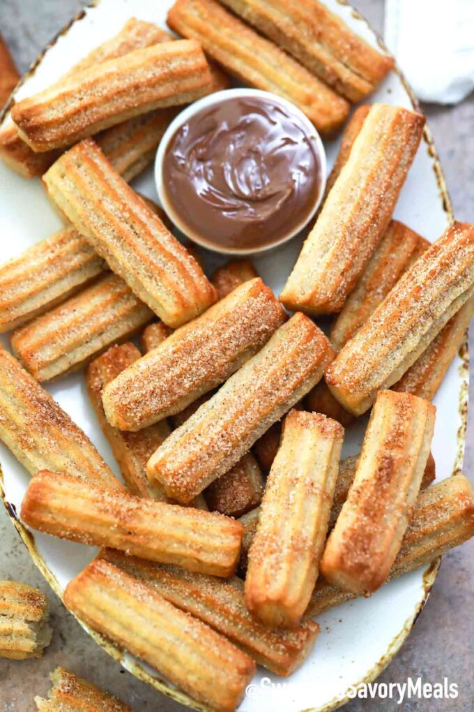 air fryer churros on a serving plate with Nutella