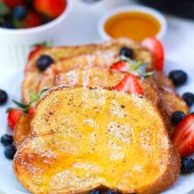 air fryer French toast with honey and berries on a plate