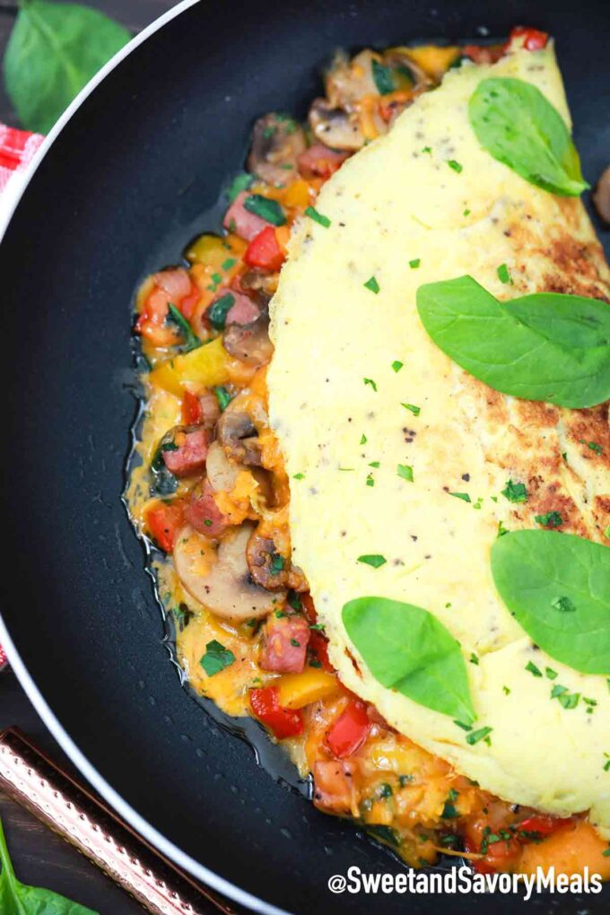 homemade omelette cooking in a skillet