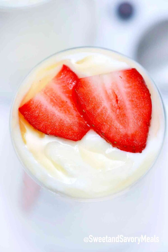 homemade crockpot yogurt with sliced strawberries and honey