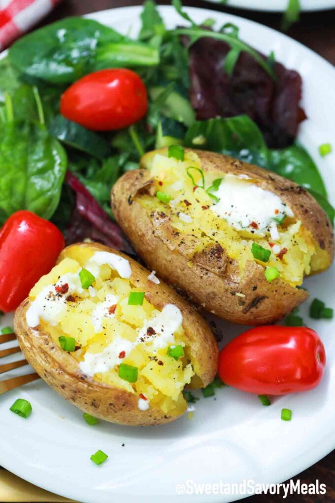 Air fryer baked potato served with salad