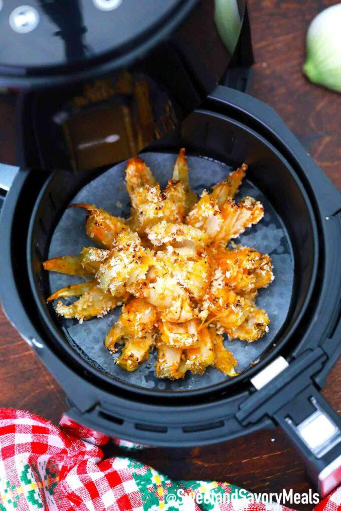air fryer blooming onion in an air fryer basket