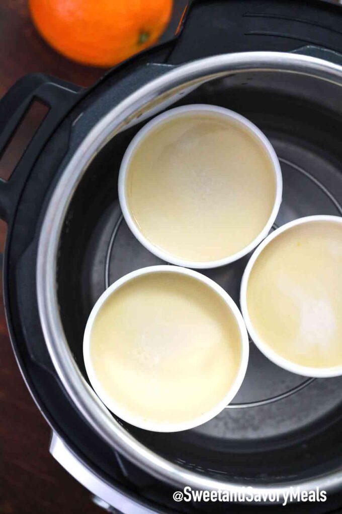 instant pot flan in ramekins on a trivet