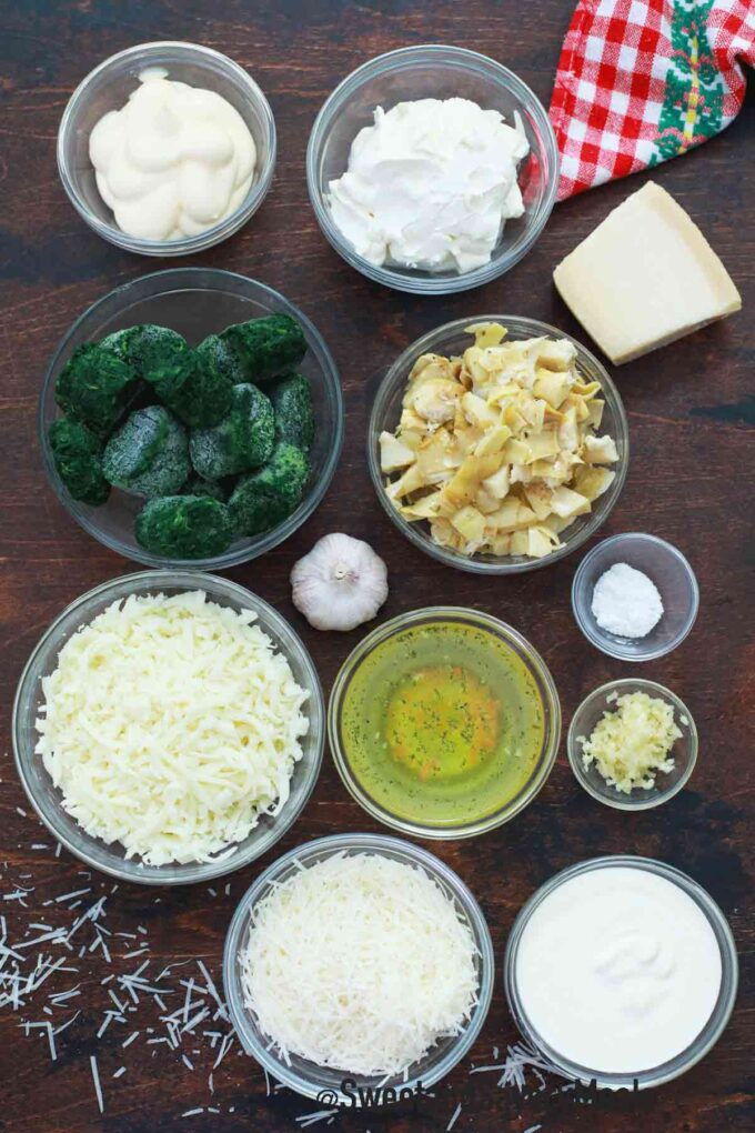 instant pot spinach artichoke dip ingredients on a wooden table