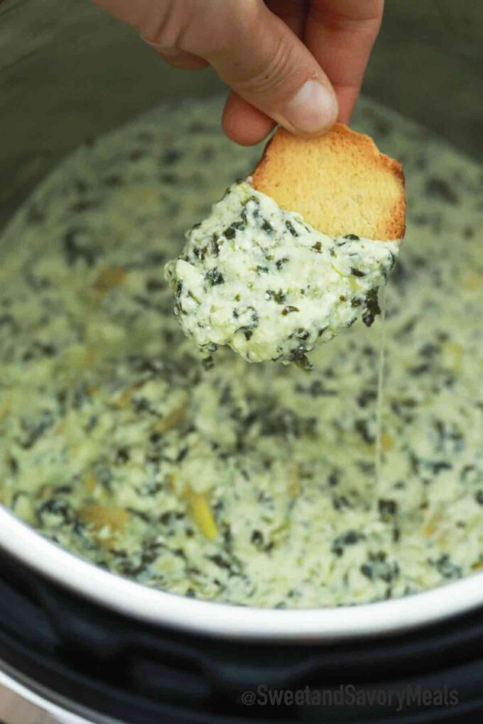 instant pot spinach artichoke dip on a crostini