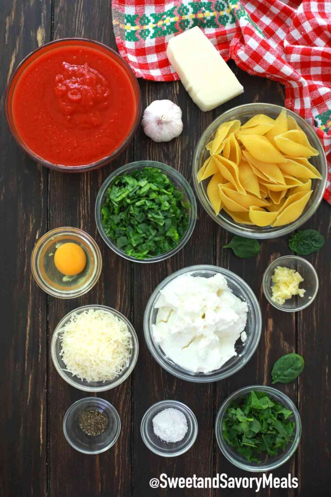 instant pot stuffed shells ingredients on a wooden table