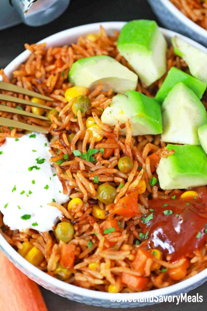 pressure cooker Mexican Rice in a bowl with toppings