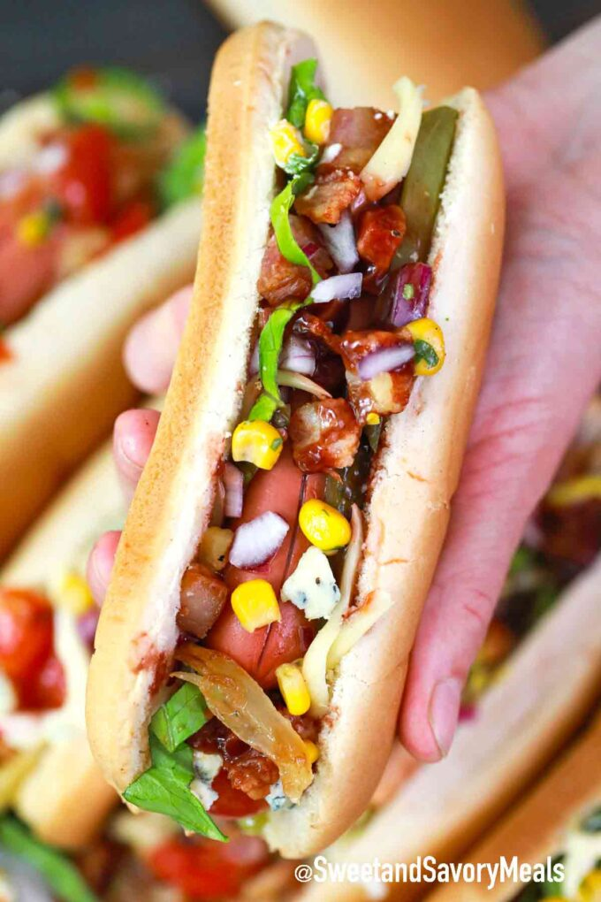 hot dog held in a palm