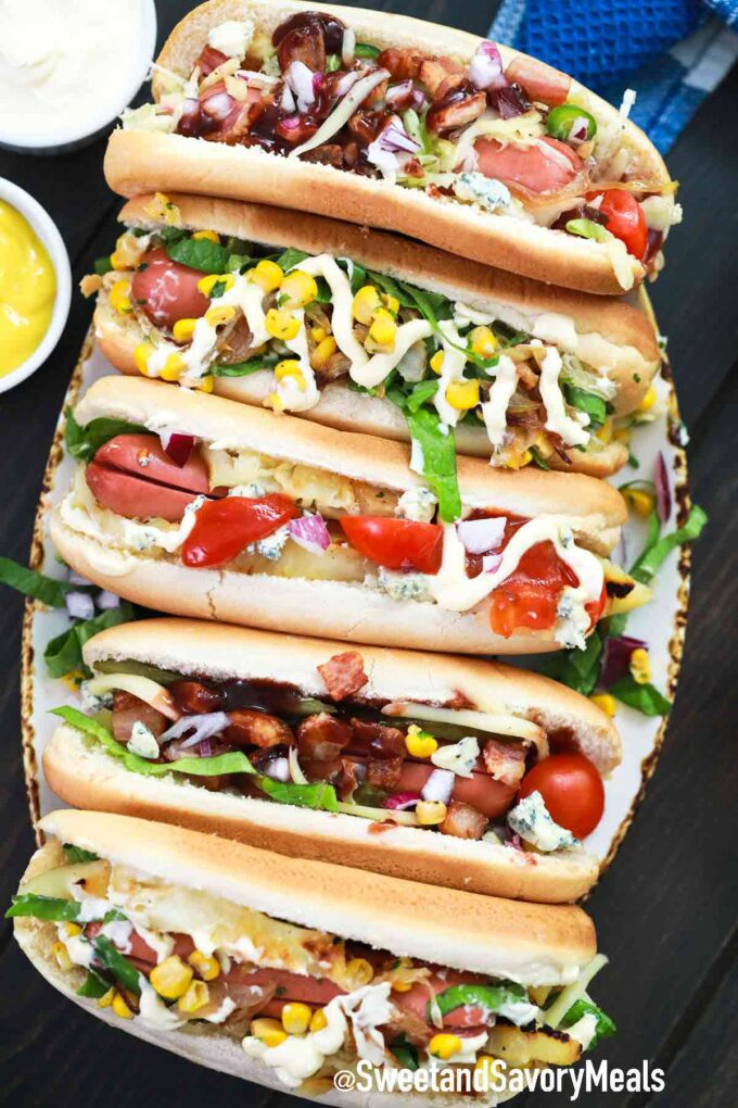 hot dogs with topping on a serving plate