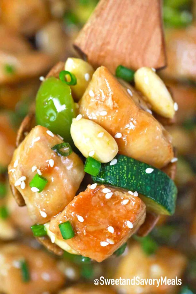 a spoonful of almond chicken and veggies