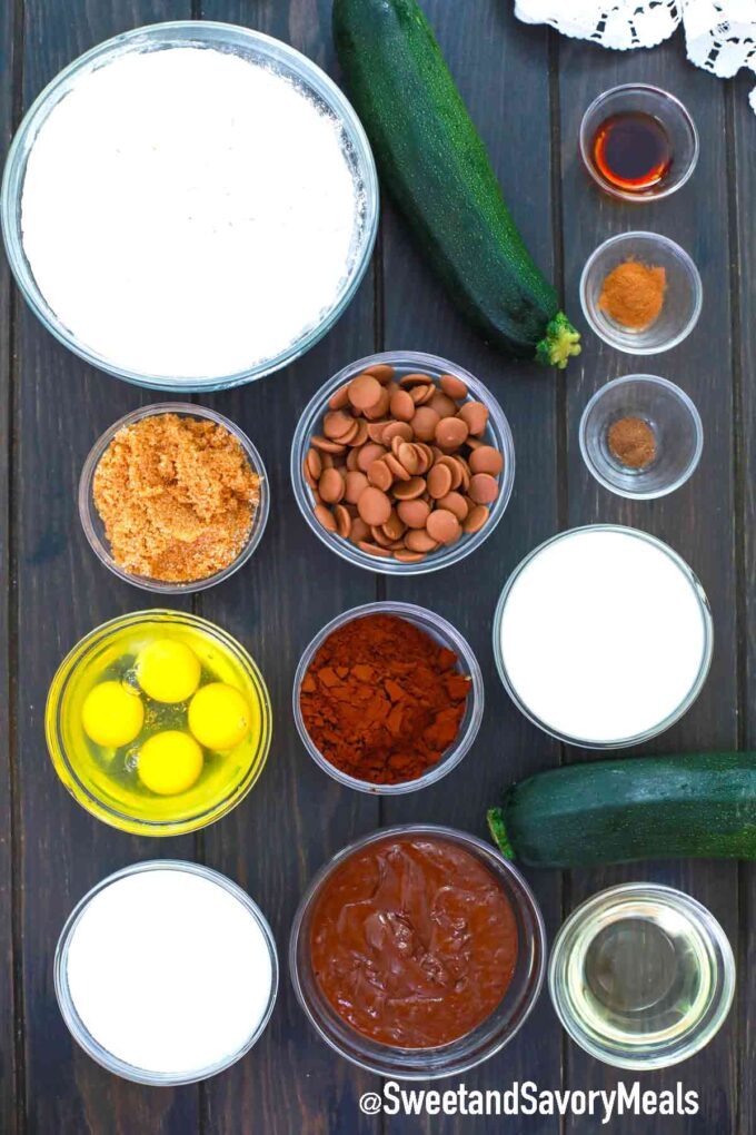 chocolate zucchini cake ingredients on a wooden table