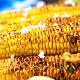 grilled corn topped with feta cheese