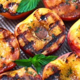 grilled peaches on a baking sheet