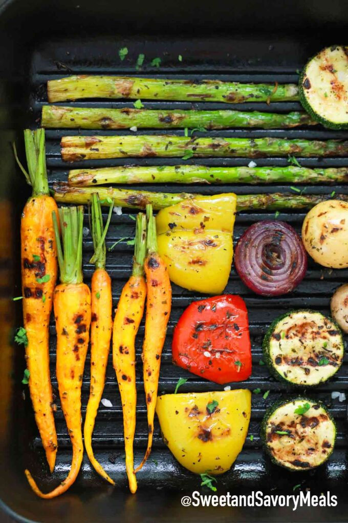 asparagus, carrots, bell peppers, zucchini, and red onion in a grill pan