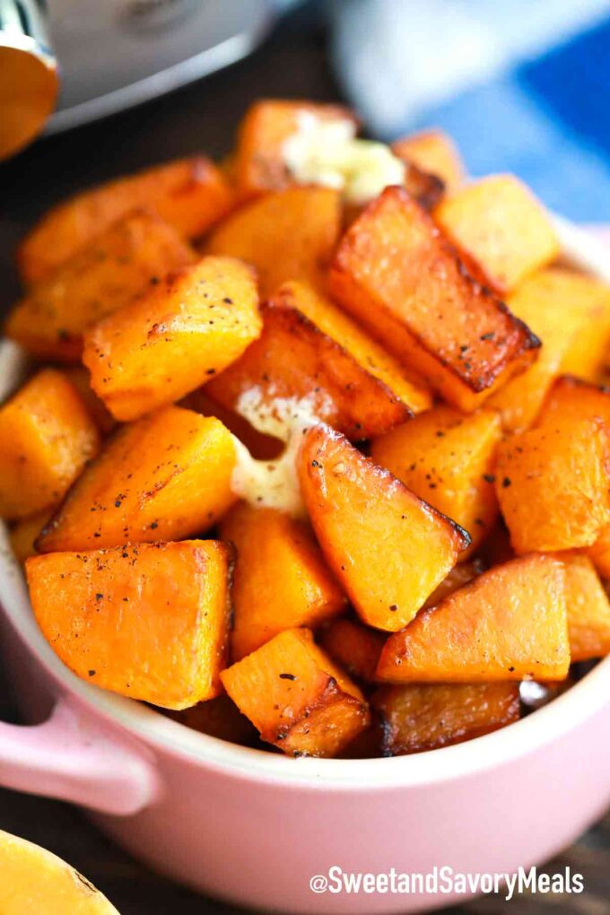 cubed and browned instant pot butternut squash in a serving bowl