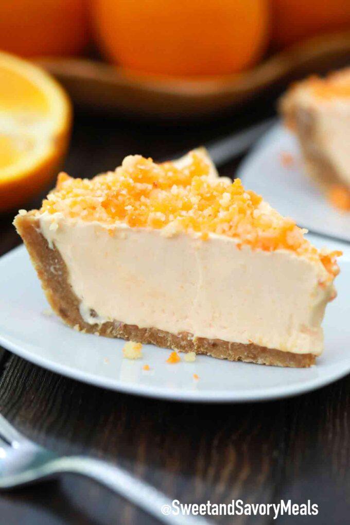 slice orange creamsicle freezer pie orange creamsicle freezer pie orange creamsicle freezer pie on a white plate
