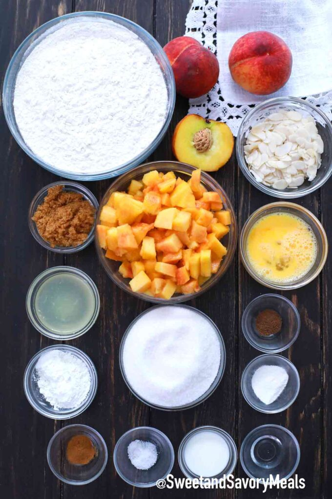 peach crumb bars ingredients on a wooden table