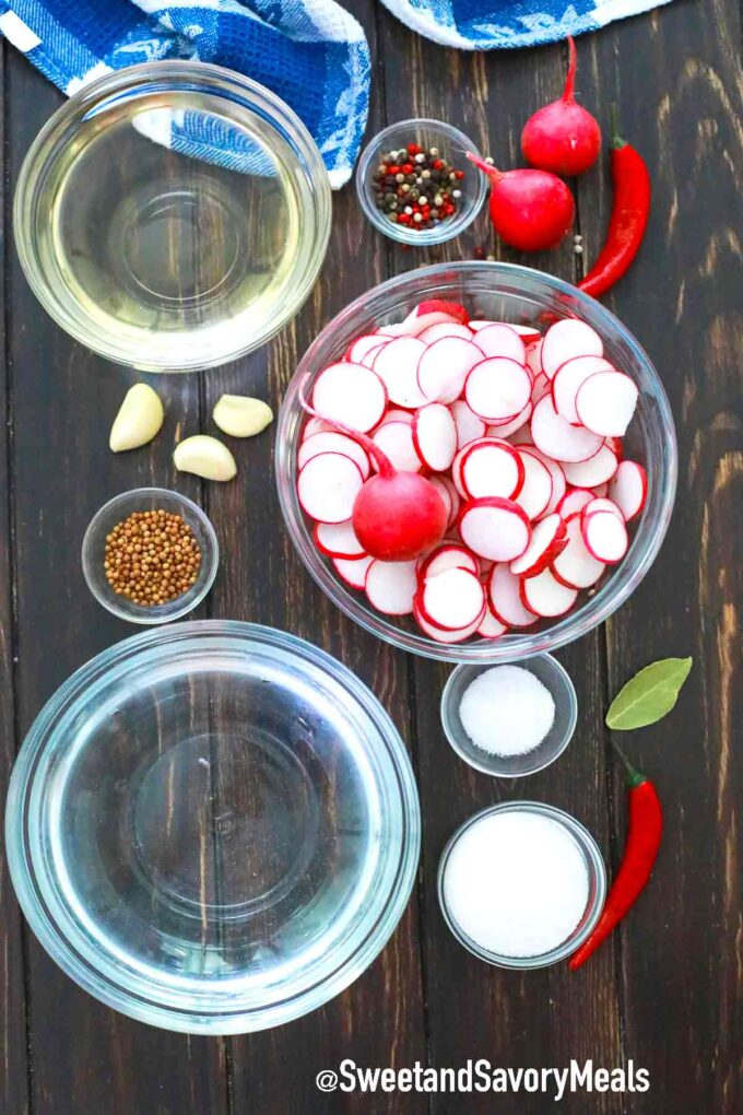 ingredients for pickled radishes on a wooden table