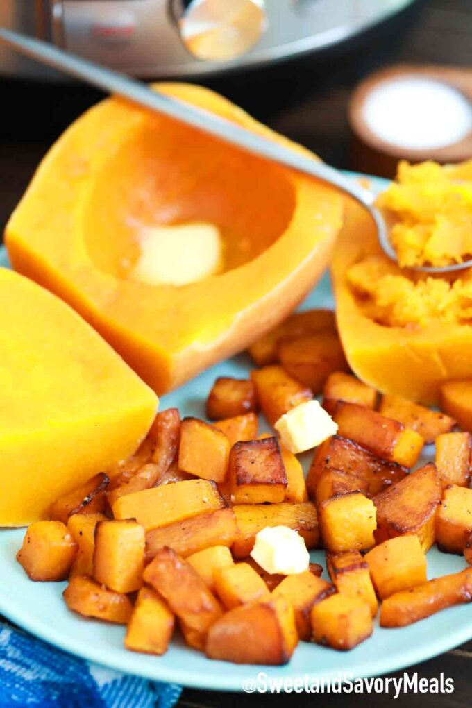 pressure cooker instant pot butternut squash cubed and halved on a plate